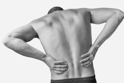 stock-photo-acute-pain-in-a-male-lower-back-monochrome-image-isolated-on-a-white-background-341735282