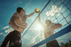 stock-photo-beach-volleyball-players-in-sunglasses-under-sunlight-dynamic-sport-action-outdoor-525074893