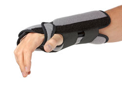 stock-photo-human-hand-with-a-wrist-brace-orthopedic-equipment-over-white-39150328