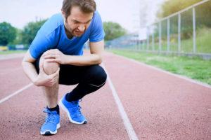 Knee strain pain of a injured runner